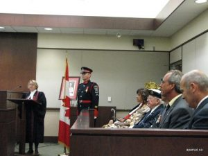 The citizenship judge, the RCMP officer, and the dignitaries