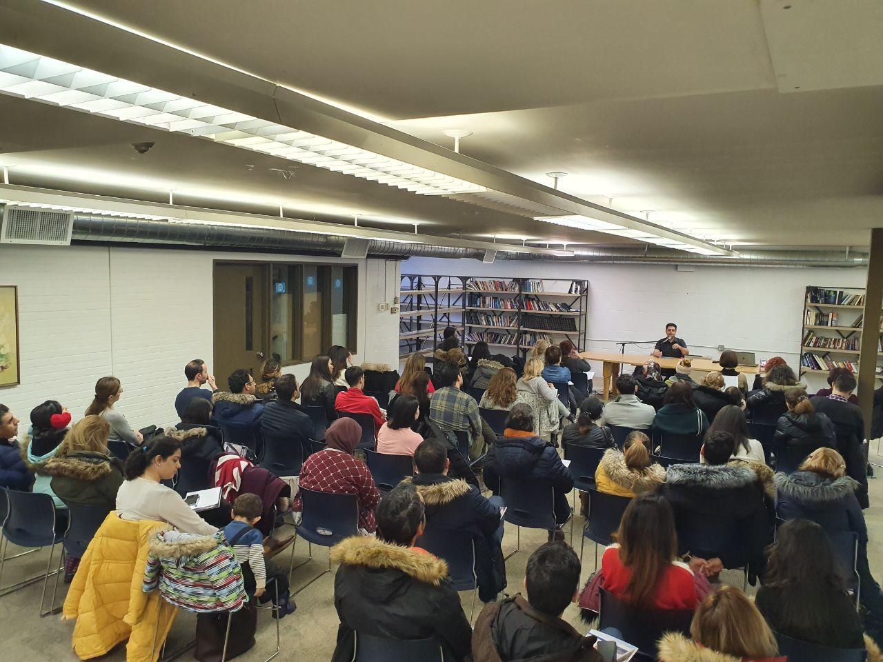 """Al Parsai holding an information session regarding sections of his number on best-seller for books about Canadian Immigration, """"88 Tips on Immigration to Canada."""""""
